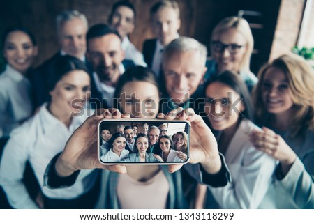 Close up blurry photo business people different age race free time excited team building hug embrace cuddle she her he him his telephone smart phone make take selfies  formal wear jackets shirts #1343118299