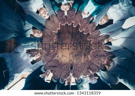 Close up low angle view photo diversity members business people circle she her he him his hold both hands arms together best brigade celebrate project nomination power formal wear jackets shirts #1343118359