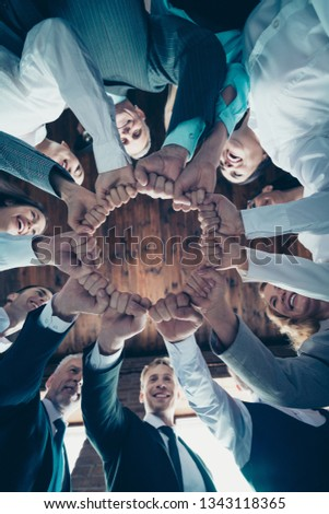 Vertical low angle view photo business people round circle she her he him his hold hands arms fists together celebrate project prize nomination power inspiration all dressed formal wear jackets shirts #1343118365