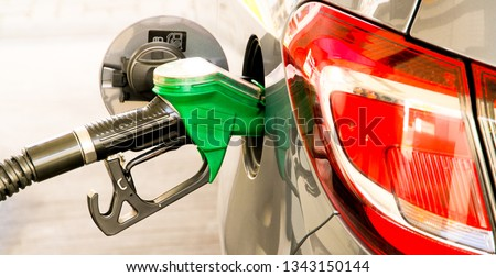 Car refuel at the petrol station. Concept photo for use of fuels (gasoline, diesel, ethanol) in combustion engines, air pollution and environmental and occupational health, oil price.  #1343150144