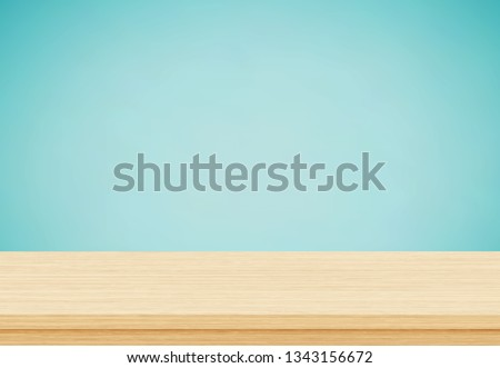 Empty wood table top on blue background, Template mock up for display of product Royalty-Free Stock Photo #1343156672
