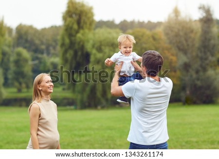 Happy family playing in the park.  #1343261174