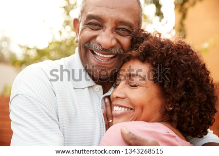 Senior black man and his middle aged daughter embracing, close up #1343268515