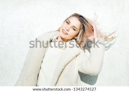 Smiling joyfully female with fair hair, dressed casually. #1343274527