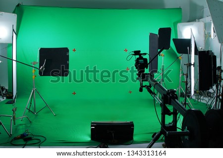 Green screen in studio with lighting equipments