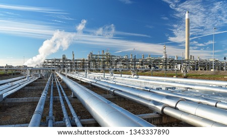 pipelines and buildings of a refinery - industrial plant for fuel production  #1343337890