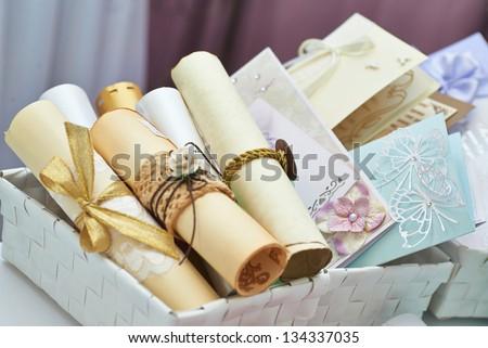 Wedding invitation scrolls in the bucket