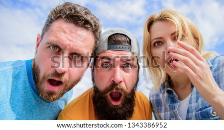 Friends shocked faces looking at you. That is impossible. Shocking news. Amazed surprised face expression. How to impress people. Shocking impression. Men with beard and woman looking shocked. No way. #1343386952