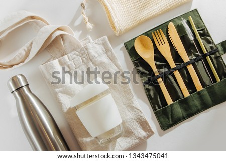 Set of Eco friendly bamboo cutlery, eco bag  reusable coffee mug  and  water bottle. Sustainable lifestyle.  Plastic free concept. #1343475041