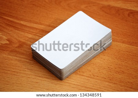 Stack of business cards with rounded corners over a wooden background