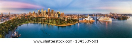 Cityscape of Sydney city CBD with major architectural landmarks on shores of Sydney harbour in early pre sunrise hour in wide aerial panorama. #1343539601