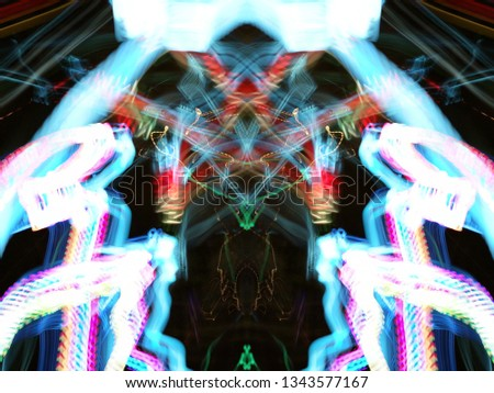 Symmetry and reflection. Neon glow. Abstract blurred background. Texture. Colorful pattern. #1343577167