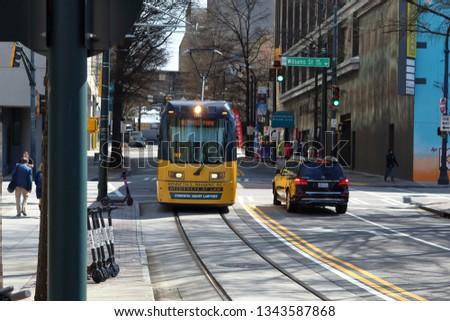 Atlanta, GA / USA - March 13, 2019: Atlanta streetcar in downtown. Royalty-Free Stock Photo #1343587868