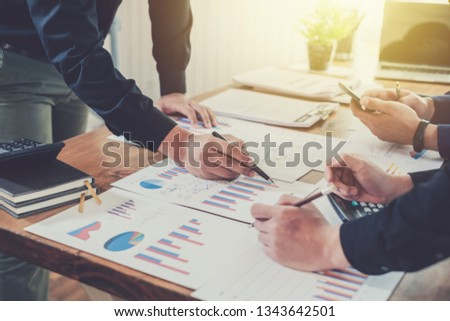 Business people hand pointing at business document during discussion at meeting. #1343642501