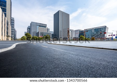 Panoramic skyline and modern business office buildings with empty road,empty concrete square floor #1343700566