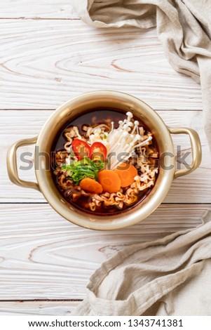 korean instant noodles in golden pot - korean food style #1343741381