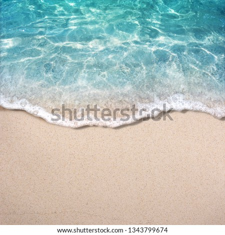 Soft blue ocean wave on clean sandy beach #1343799674