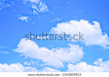 Blue sky in sunny day with brilliant white puffy clouds in rounded tops ,flat bottoms calls Cumulus clouds (cumulus humilis ,cumulus fractus) for summer season concept ,freshness natural background #1343809853