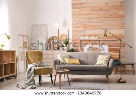 Stylish living room interior with comfortable sofa. Idea for home decor #1343840978
