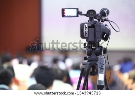 The video recorder is recording the open and free event with blurred background. #1343943713