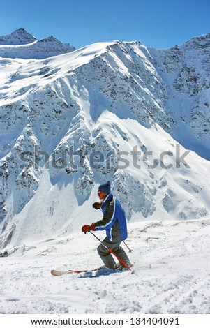 A skier against the background of mountains #134404091