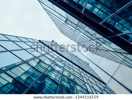 Building facade with blue sky . Amazing perspective. #1344116159