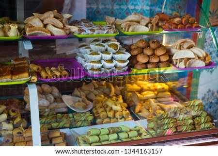 Delicious Bakery sweets and bakery products lying on counter  at the entrance to  Paris Mosque #1344163157