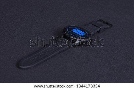 Black smartwatch isolated on a black background, new message #1344173354