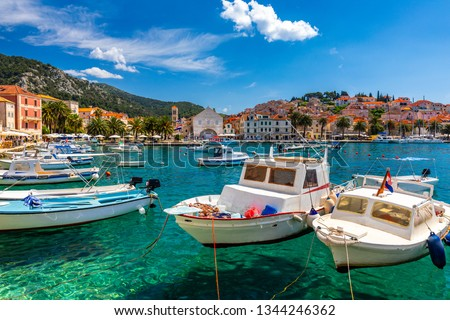 View at amazing archipelago with boats in front of town Hvar, Croatia. Harbor of old Adriatic island town Hvar. Popular touristic destination of Croatia. Amazing Hvar city on Hvar island, Croatia.  #1344246362
