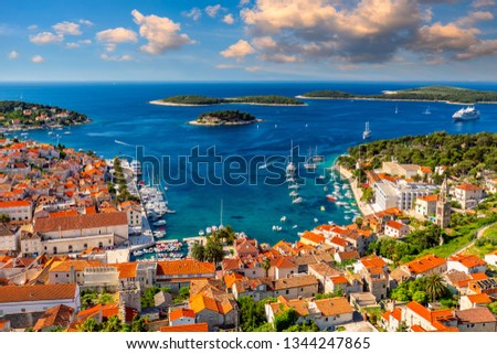 View at amazing archipelago in front of town Hvar, Croatia. Harbor of old Adriatic island town Hvar. Popular touristic destination of Croatia. Amazing Hvar city on Hvar island, Croatia. #1344247865