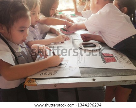 March 20, 2019, at 08.30 clock. In the morning, a group of students were painting on paper in Lamphun School. #1344296294