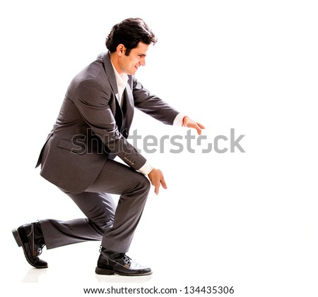 Business man holding something with his hands - isolated over white #134435306