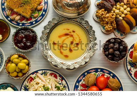 Traditional Turkish Ramadan,iftar meal table with lentil soup on the middle of table with other foods.Used Traditional Turkish Ceramic utensils and copper soup bowl together. #1344580655