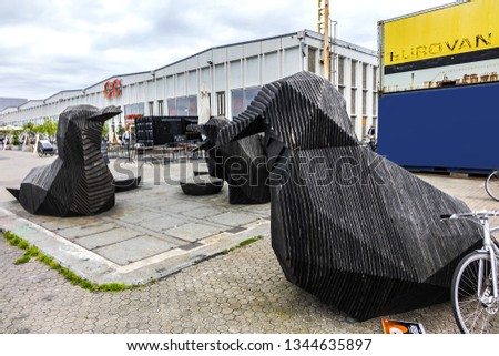 COPENHAGEN, DENMARK - JUNE 21, 2017: Giant Duck and seagulls statues at Street Food near Copenhagen Papiroen and Contemporary (CC) Art Center. #1344635897