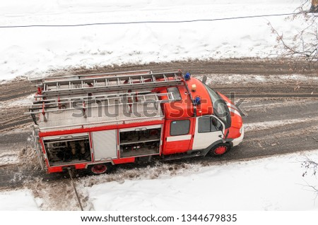 fire truck top view on the road in winter