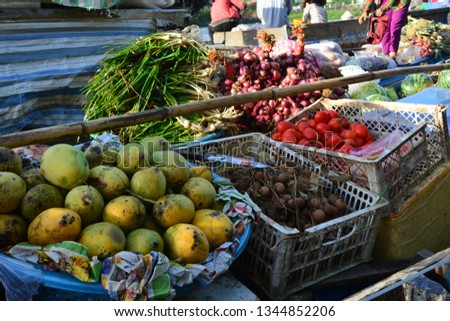 Fruits being sold at the floating market of Phong Dien at the mekong river, near Can Tho, Vietnam #1344852206