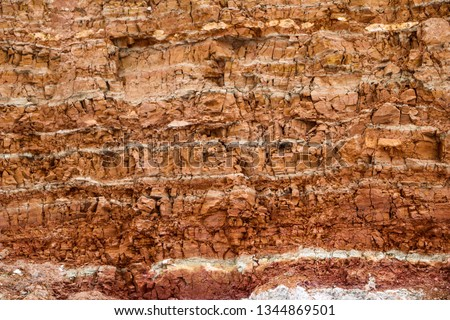 the texture of different layers of clay underground in a clay quarry after geological study of the soil. #1344869501