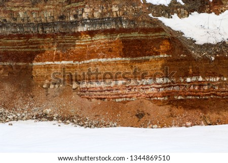 the texture of different layers of clay underground in a clay quarry after geological study of the soil. #1344869510