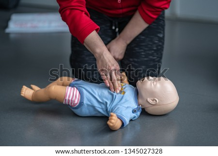 Resuscitating of the child Royalty-Free Stock Photo #1345027328