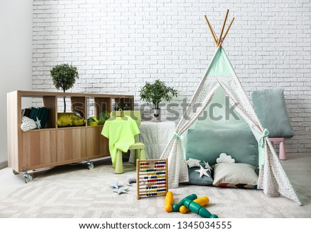 Stylish interior of kid room with hovel #1345034555