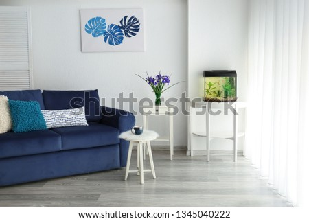 Interior of room with beautiful aquarium