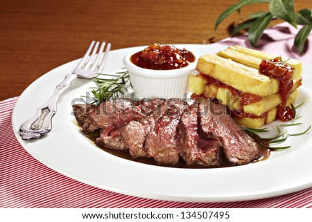 sirloin steak with fried potatoes and tomato sauce #134507495