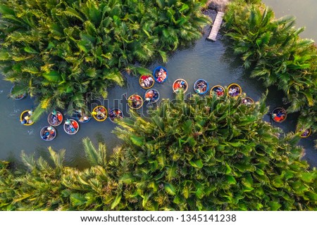 Aerial view, tourists from China, Korea, America and Russia are relax and experiencing a basket boat tour at the coconut water ( mangrove palm ) forest in Cam Thanh village, Hoi An, Quang Nam, Vietnam Royalty-Free Stock Photo #1345141238