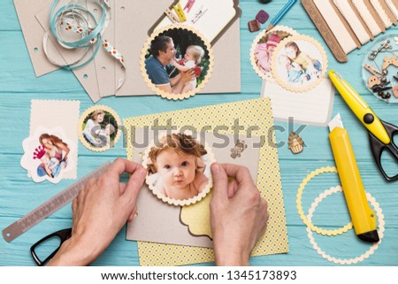 scrapbook background. the process of creating a childrens album. Card and tools with decoration  #1345173893