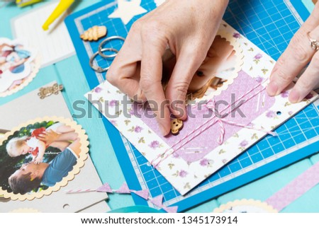 scrapbook background. the process of creating a childrens album. Card and tools with decoration  #1345173914