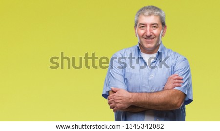 Handsome senior man over isolated background happy face smiling with crossed arms looking at the camera. Positive person. #1345342082