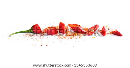 Red chili pepper, cut into pieces and isolated on white background. Hot spice, red chili pepper and chili powder.  #1345353689