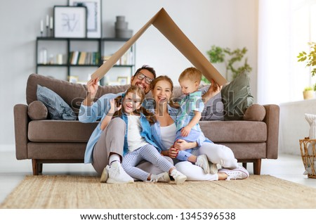 happy family mother father and child son draw together at a home  