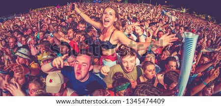 BENICASSIM, SPAIN - JUL 22: The crowd in a concert at FIB Festival on July 22, 2018 in Benicassim, Spain. #1345474409