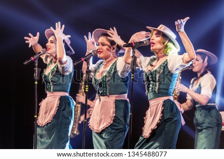 ODESSA, UKRAINE - MARCH 17, 2019: Bright music show FREEDOM JAZZ. Beautiful female jazz band on stage in a bright musical jazz show. Sexy women musicians on stage in an erotic musical performance #1345488077